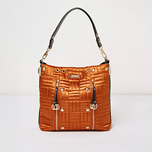 Orange quilted slouch bag