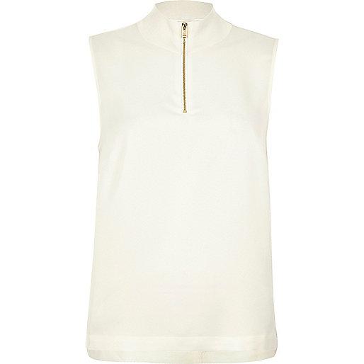 White sleeveless high neck top