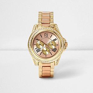 Montre chaîne dorée et couleur or rose