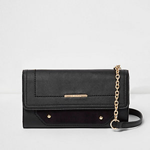 Black foldover faux suede panel bag