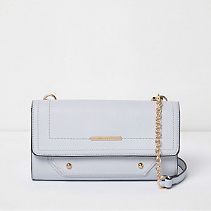 Blue fold over cross body handbag