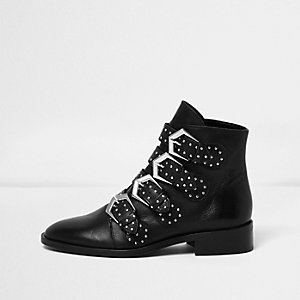 Black leather stud buckled ankle boots