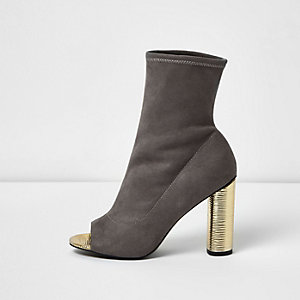 Grey peep toe gold heel sock boots