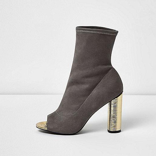 Grey peep toe gold heel sock boots