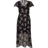 Schwarzes Cape-Kleid mit Rüschen und Blumenmuster
