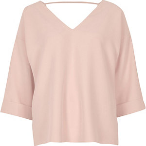 Light pink strap back blouse