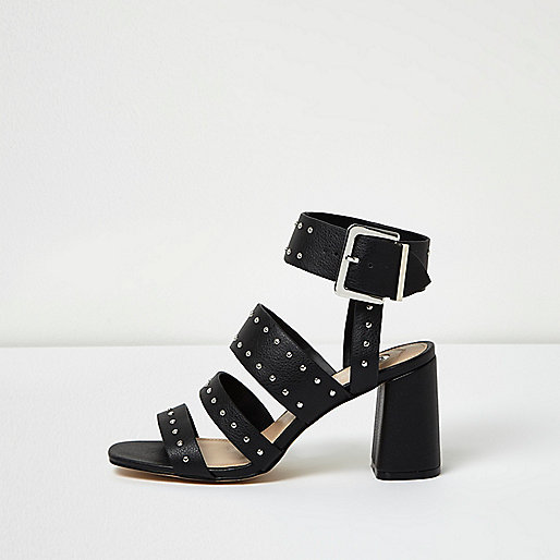 Schwarze Sandalen mit Blockabsatz und Nieten