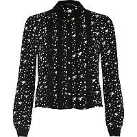 Chemise imprimé étoiles noire avec volants sur le devant