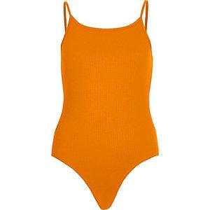 Orange strappy bodysuit