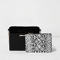 Black bag and snake print purse