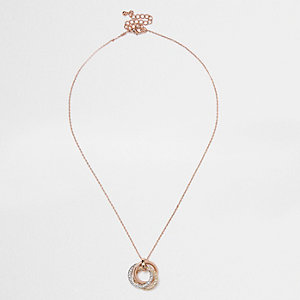 Rose gold tone twisted ring necklace