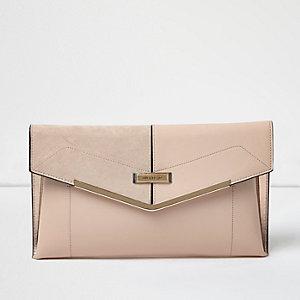 Blush pink envelope clutch bag with gold bar