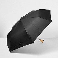Schwarzer Regenschirm mit Entengesicht