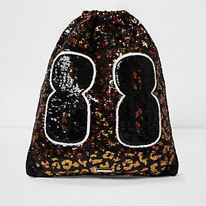 Schwarz-goldene Tasche mit Kordelzug