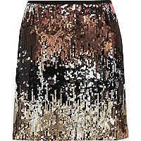 Mini-jupe argentée en dégradé ornée de sequins
