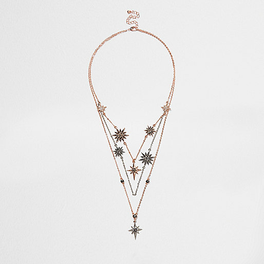 Rose gold tone layered star burst necklace