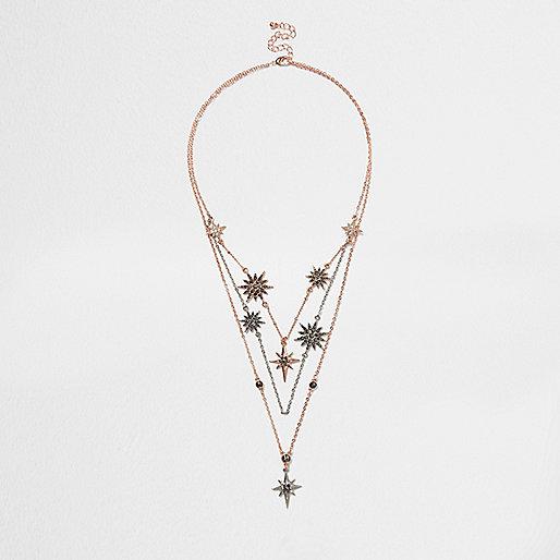 Collier multi-rangs or rose orné d'éclats d'étoiles