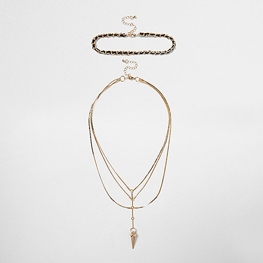 Gold tone spike drop necklace