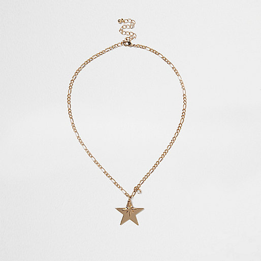 Gold tone star chain necklace