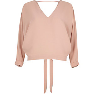 Light pink tied batwing top