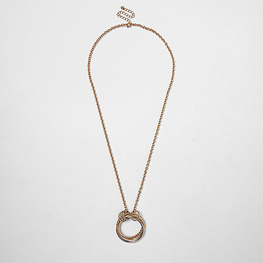 Gold and silver tone twisted ring necklace