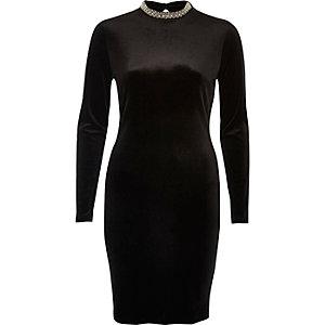 Mini robe en velours noir à col roulé orné de bijoux
