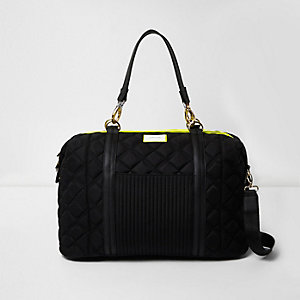 Black quilted sports holdall bag