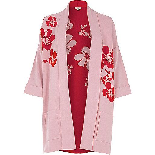 Cardigan rose et rouge en maille à fleurs