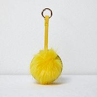Porte-clés miroir jaune à pompon