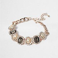 Bracelet doré rose serti de perles