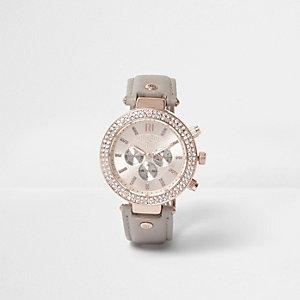 Plus – Graue Armbanduhr mit Verzierungen