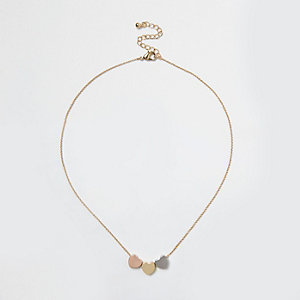 Gold tone multi heart necklace