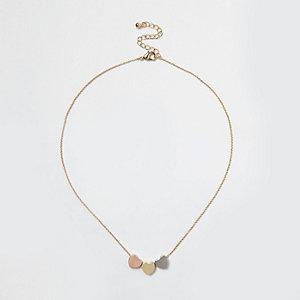 Gold tone multi heart necklace
