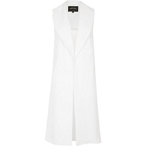 White sleeveless duster jacket