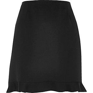 Mini-jupe noire à ourlet volanté