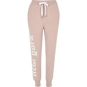 Pantalon de jogging rose avec inscription