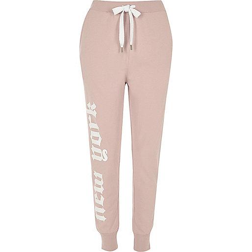 Pantalon de jogging rose avec inscription