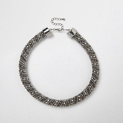 Silver tone diamanté twist necklace