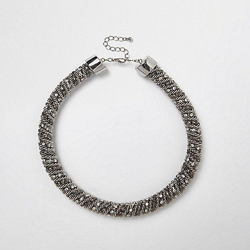 Silver tone diamanté twist necklace