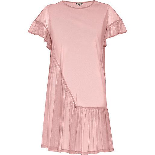 Robe rose tendre à volants en tulle et smocks