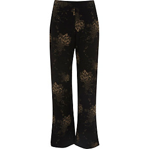 Black floral print wide leg trousers