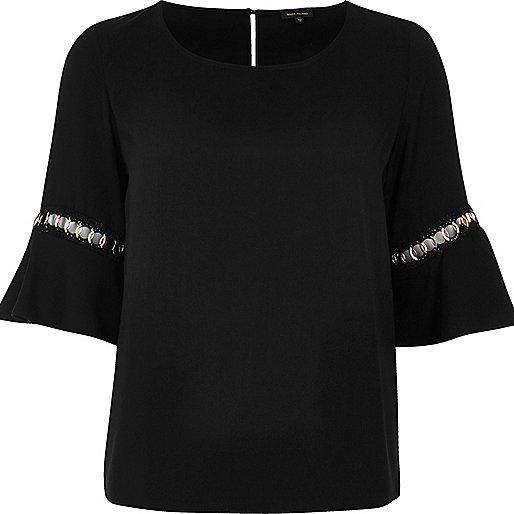 Black bell sleeve top