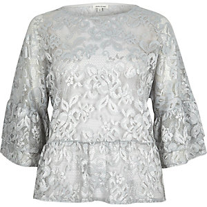 Light grey lace flared top