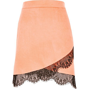 Pink faux suede lace hem mini skirt