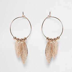 Rose gold tone hoop feather earrings