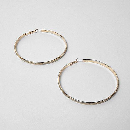 Gold tone glitter hoop earrings