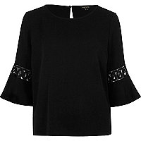 Black crochet flute sleeve top