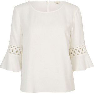 Cream crochet flute sleeve top