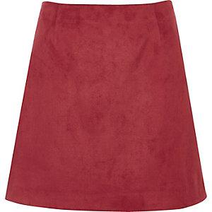 Mini-jupe en suédine rouge foncé