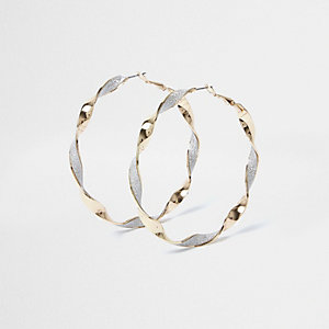 Gold tone glitter twist hoop earrings